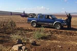 מסוק נוחת ליד רכב החשוד בצייד